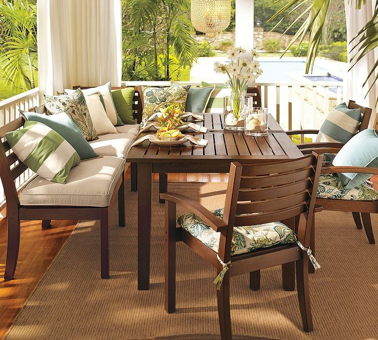 Back Porch Dining With Cushioned Seating And White Railing Backyard Pinterest Pottery Barn