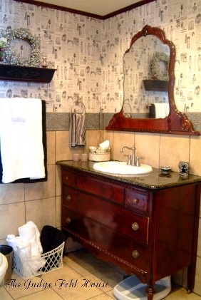 antique dresser converted to a vanity for a master bathroom
