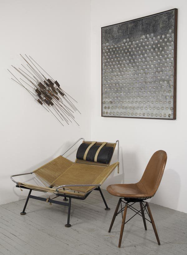 Midcentury wall sculpture, strange sculptural chair and a grey hues painting