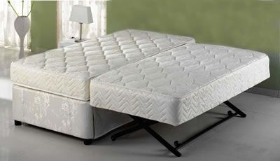A Trundle Day Bed That Converts To Two Twin Mattresses Or Pops Up Easily Create One Combined King Size Mattress Suitable As Guest