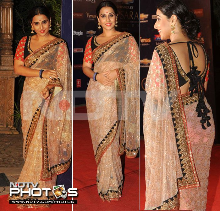 Actor Vidya Balan in a light orange net Sabyasachi http://www.sabyasachi.com/ Saree at Apsara Awards, Jan, 12.
