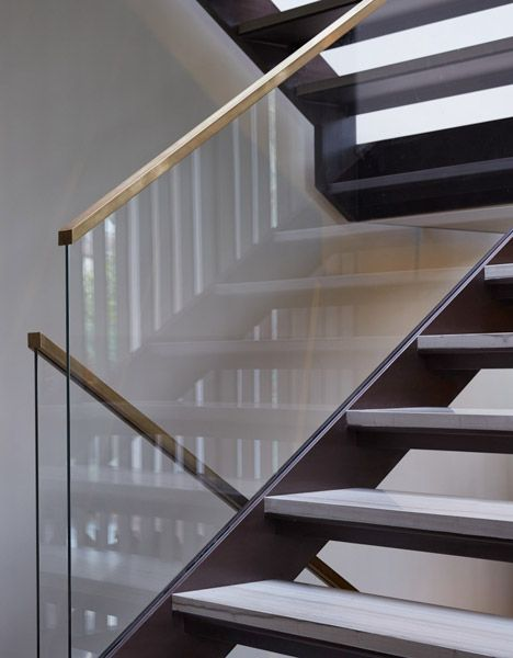 Fitzroy Park House by Stanton Williams.  Beautiful glass / bronze handrail detail. photo by Edmund Sumner