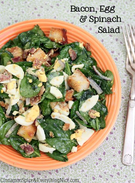 TOSSED BACON, EGG & SPINACH SALAD     5 slices bacon  3 cups cubed Italian bread (1/2-inch cubes)  coarse salt and fresh black pepper  Dressing:  1/3 cup olive oil  4 tablespoons Dijon honey mustard  1 clove garlic, chopped  Salad:  4 hard-boiled eggs, sliced  6 cups baby spinach, stems removed  scant 1/4 cup thinly sliced red onion