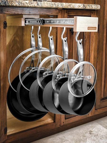 This dreamy drawer organizer mounts to the top of any base cabinet and arrays your pots and pans (and their lids) on a single extending rack with adjustable hooks. Dual glides on ball bearings make it one smooth operator. Pull-Out cookware Storage, by @glideware
