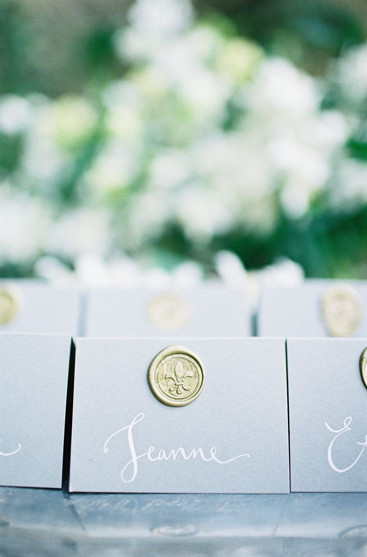 Wax Seal Adorned Place/Escort Cards | Calligraphy by Kathryn Murray Read more - http://www.stylemepretty.com/2014/01/31/romantic-grey-gold-wedding-inspiration/