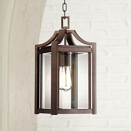 A handsome bronze outdoor hanging light that blends contemporary design with a traditional finish.