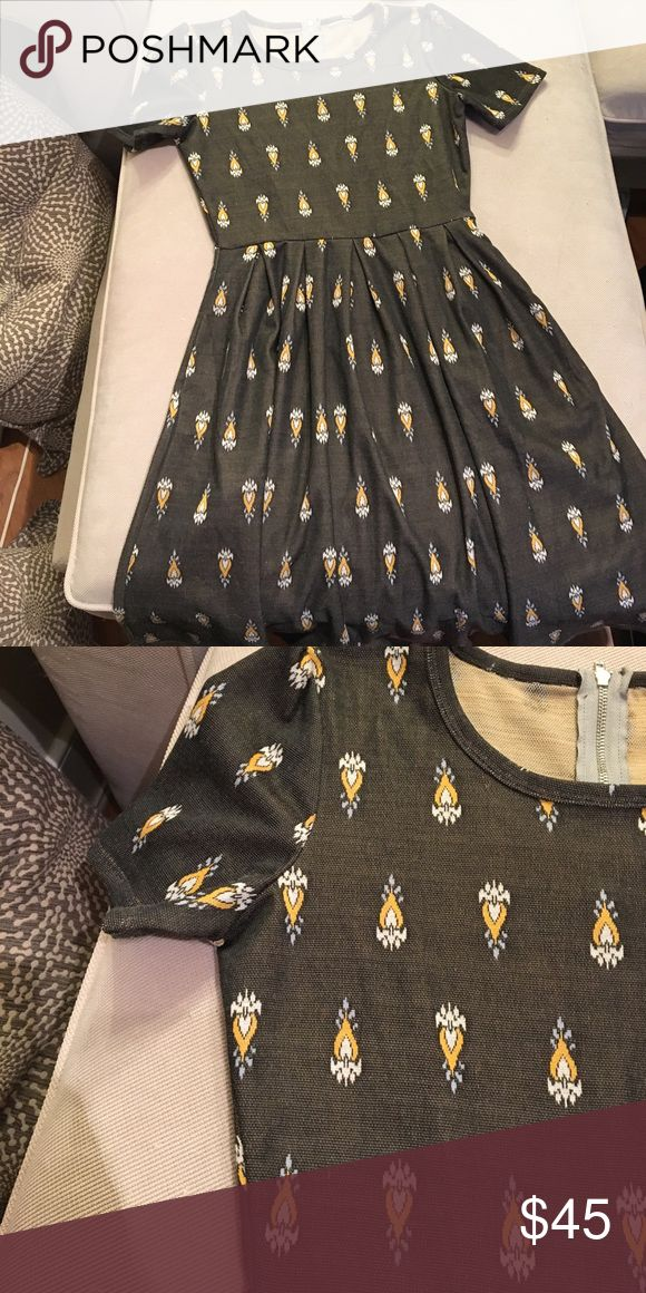 Lularoe Amelia dress This Lularoe Amelia is in great condition, the consultant I bought from was going out of business which is why tag is cut out but I'm sure of size. It's such a gorgeous pattern and could be dressed up or dressed down! I ❤️ offers! LuLaRoe Dresses