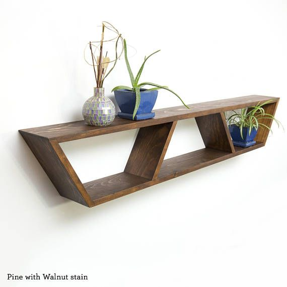 Listing Information ------------------------------ Available in a variety of wood types and finishes, it is the perfect geometric addition to any modern space! Inspired from Mid Century Modern design, this heavy-duty floating trapezoid shelf offers clean,