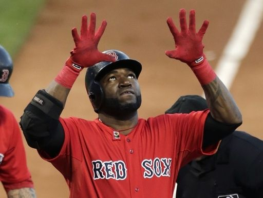 Boston Red Sox designated hitter David Ortiz raises his arms as he crosses home plate on a two-run home run in the first inning during a baseball game against the Arizona Diamondbacks at Fenway Park in Boston, Friday, Aug. 2, 2013. (AP Photo/Charles Krupa)