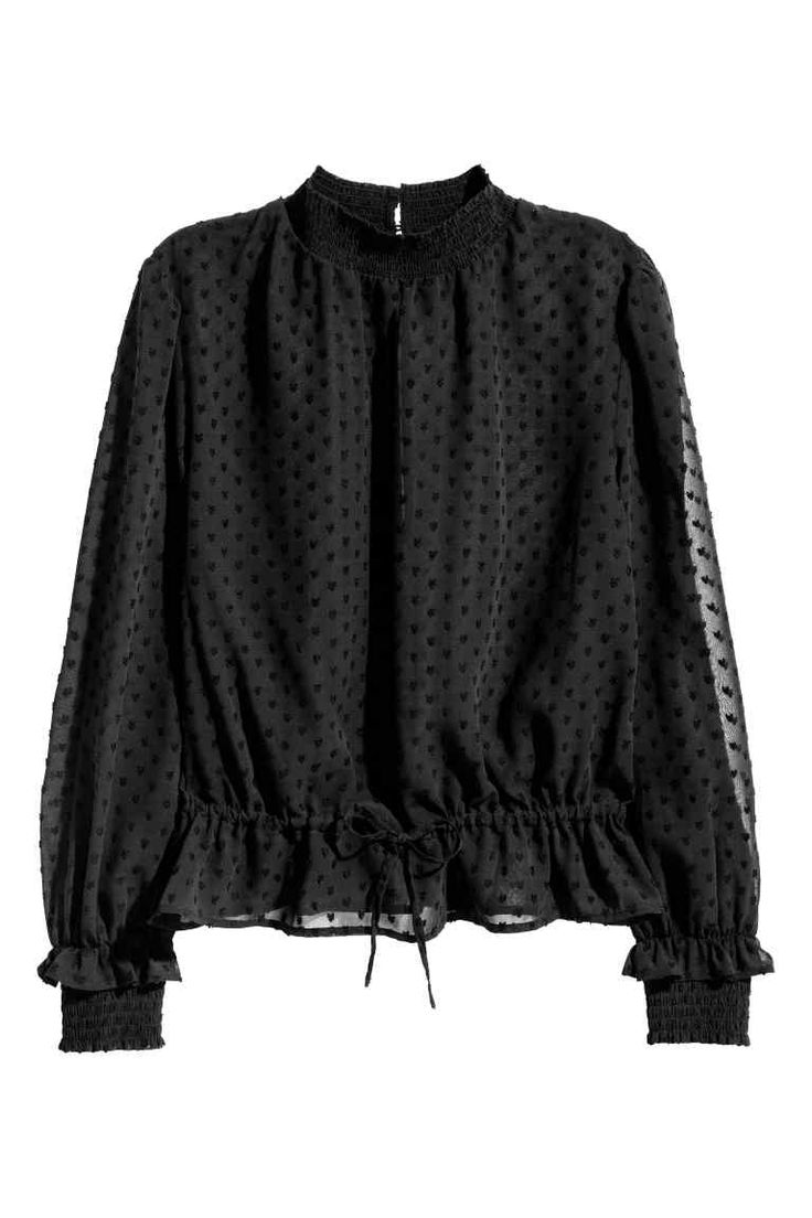 Textured blouse: Long-sleeved blouse in an airy, transparent textured weave with an opening and button at the back of the neck, drawstring at the waist and smocking around the neckline and cuffs.