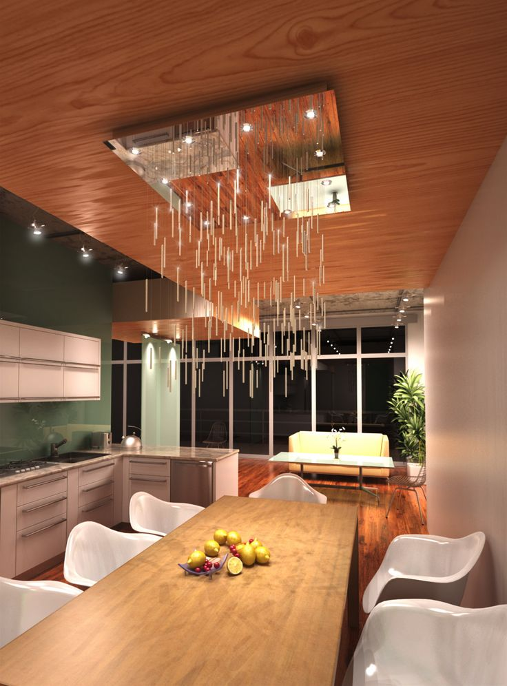 Modern chandelier made of glass tubes filled with crystals hanging on sparkling fiber optics. Serial production.