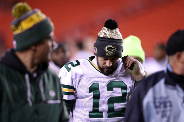 Aaron Rodgers Photos Photos - Quarterback Aaron Rodgers #12 of the Green Bay Packers walks off of the field after the Green Bay Packers were defeated by the Washington Redskins 24-42 at FedExField on November 20, 2016 in Landover, Maryland. - Green Bay Packers v Washington Redskins