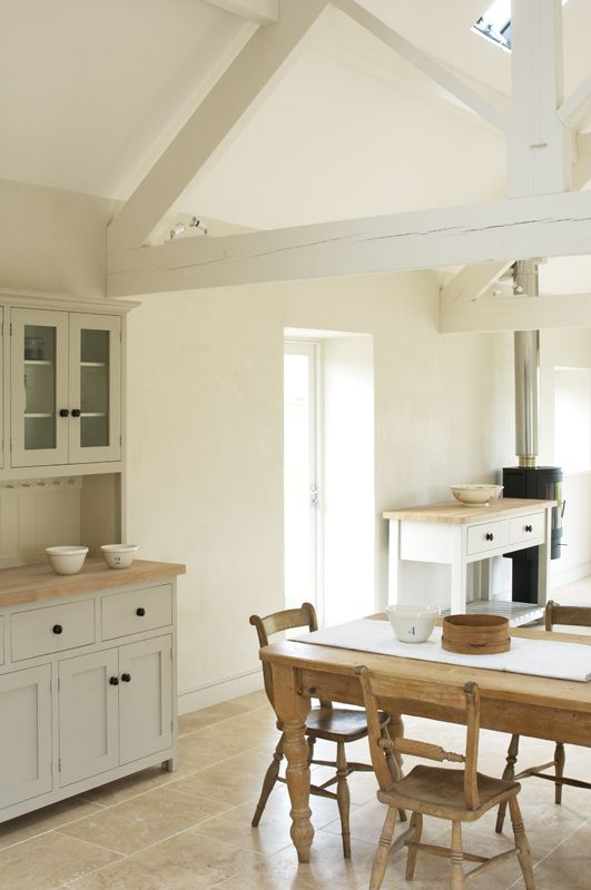 The Ashbourne Shaker Kitchen by deVOL - A beautifully renovated barn in the Peak District is the setting for this Shaker kitchen. The muted tones of our Mushroom and Putty paint sit very well in these rural surrounds. A large dresser and server help bring the living and kitchen areas together for a simple and inspiring living space.
