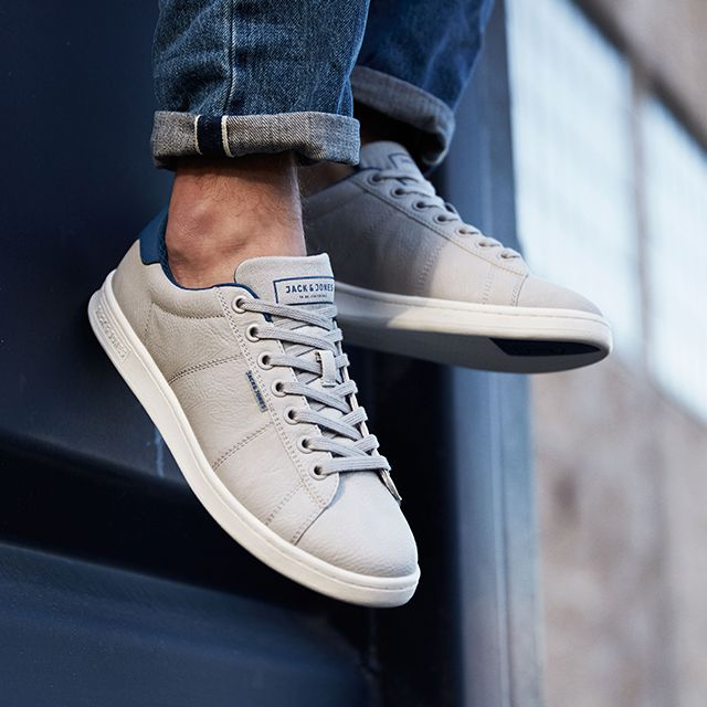 Classic grey leather-look court-style sneakers, with blue details and white  rubber