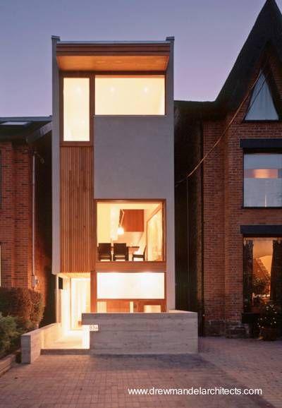 La vivienda cuenta con tres niveles - Arquitectura de www.drewmandelarchitects.com
