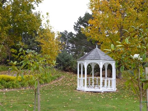 Say your I do's in a cute rotunda like this placed in a beautiful spot of your garden venue.