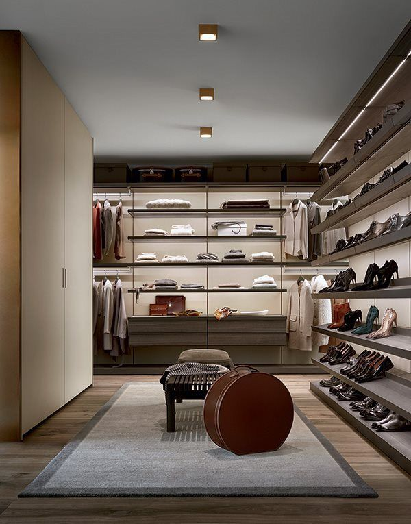 Ubik walk-in closet with wall mounted panels in latte mat lacquered Skin melamine, wardrobes Skin with coplanar opening, Home Hotel Collection bench in black elm with cushion in removable.