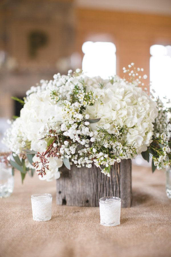 Baby's Breath mixed with hydrangea and some wax flower to give it a bit more texture - like the lace wrapped votive holders