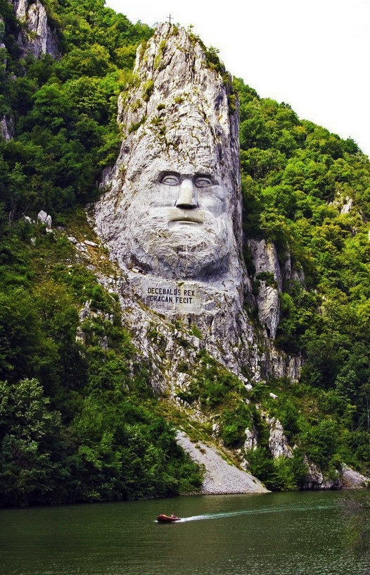 King's Decebal face carved in rock on the shores of Danube River, Romania.