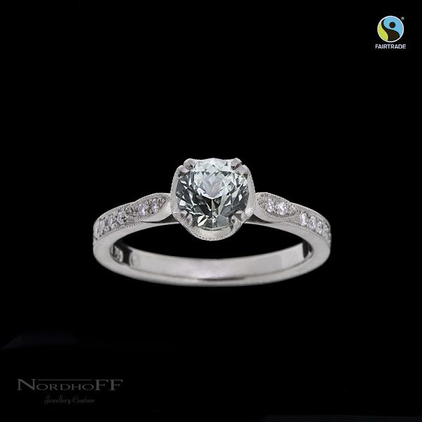 Fall in love with this completely handmade engagement ring. Ethically sourced Fairtrade satin finished white gold presents the delicious misty apple green custom cut sapphire in the most perfect way. Timeless, Distinctive, Opulent. Classic with a modern twist.