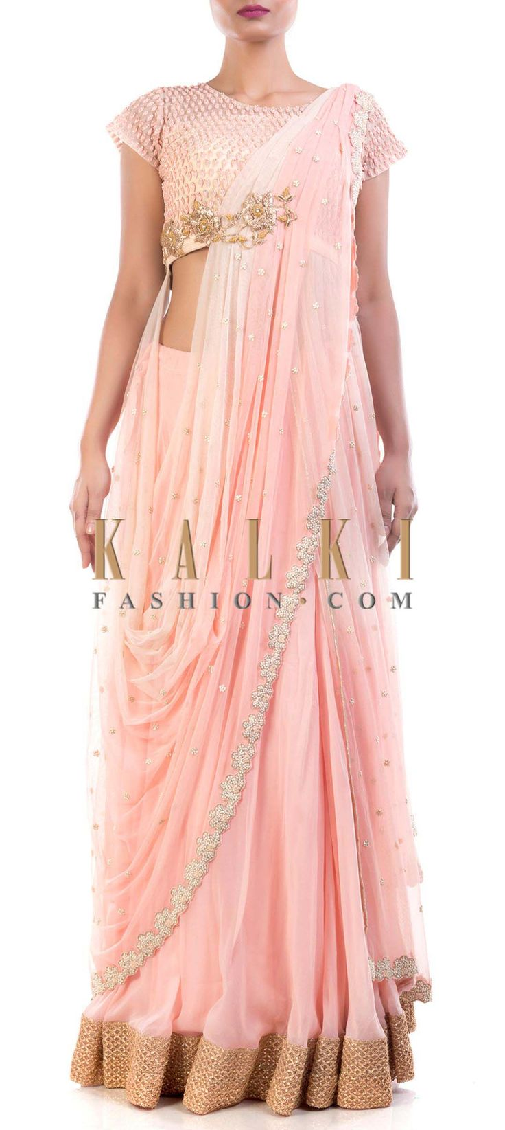 Buy Online from the link below. We ship worldwide (Free Shipping over US$100) Price- $509 Click Anywhere to Tag http://www.kalkifashion.com/peach-lehenga-and-blouse-with-attached-dupatta.html