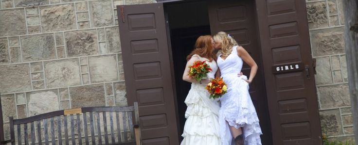 Beautiful lesbian brides pose for a photo at the Country Heritage Park in Toronto Ontario with gay friendly photographer 2Bride Photography!