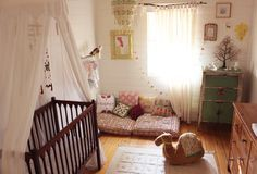 This Australian nursery is playfully Bohemian, complete with vintage pieces, cute bunting and branch curtain rods!