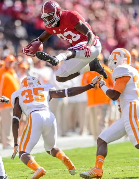Alabama wide receiver Kevin Norwood (83) hurdles Tennessee defensive back JaRon Toney (35). (Vasha Hunt/AL.com/AP)