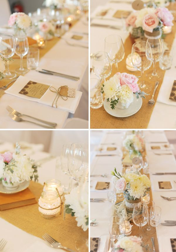 table runners topped with vintage books, votive jars + loads of floral arrangements in jars and vintage tea and coffee cups.