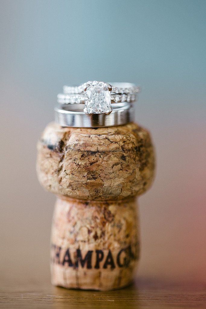 Photo Tip: If you kept it, place rings atop the cork of the champagne bottle you used to celebrate your engagement.  Photo by Jasmine Star via Style Me Pretty