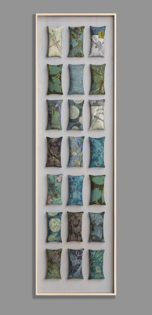Mixed media collection of fabric and found object amulets.. Original Fiber Art