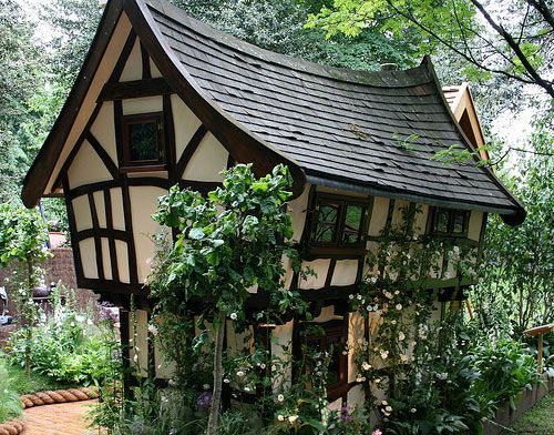 Tudor cottage- love the warped roof, gives it so much character