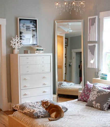 The large mirror could also work in your corner? This one has grey walls and white trims and furniture, you could soften the look by using cream, grey or the blush pink colours we've talked about for skirting, shutters and furniture