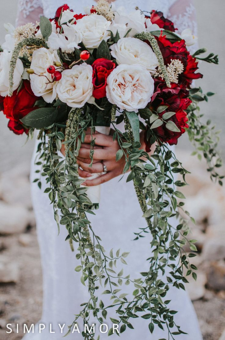 Cascading red and white bouquet with falling vine leaves. I absolutely loved this bouquet!! Silver Lake mountain wedding. DIY wedding bouquet with cascading, wildflower themes. This bouquet is handmade DIY and isn't real flowers. I'm impressed! :)