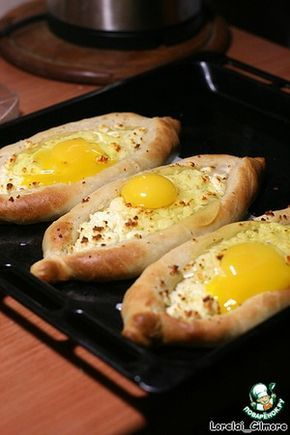 """Аджарские хачапури - (Russian) - Ingredients for """"Ajarian khachapuri"""":      Adyghe cheese - 300 g     Flour - 300 g     Yeast (dry) - 5 g     Vegetable oil - 90 g     Egg - 4 pieces     Sugar (pinch)"""