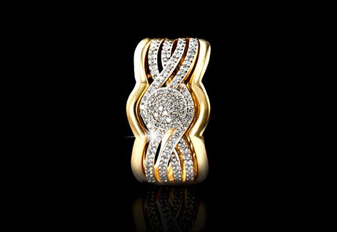 The Pavé Ring is a crossover ring in 9ct yellow gold with 0.25ct of diamond pavé detail on the bands and in the centre, creating a warm texture. Too lovely!