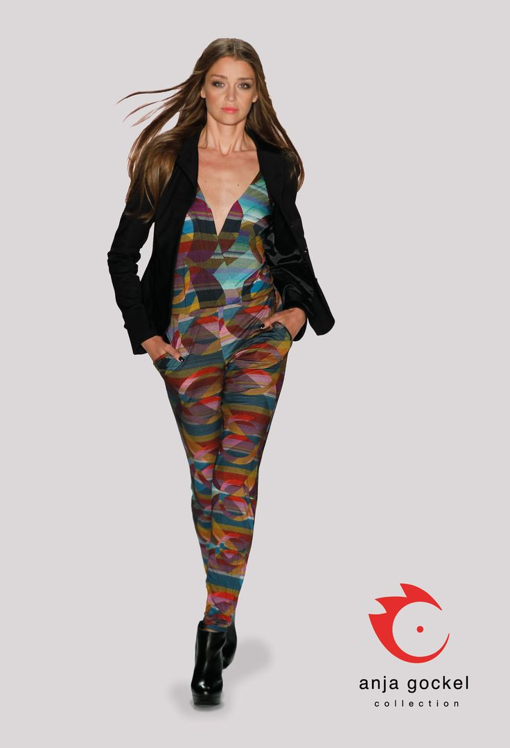 This seasons darling, the elegant jumpsuit with V-neck and long sleeves. This garment is made from light rayon jersey in psychedelically print. The classy blazer that perfects this outfit is made from techno stretch.