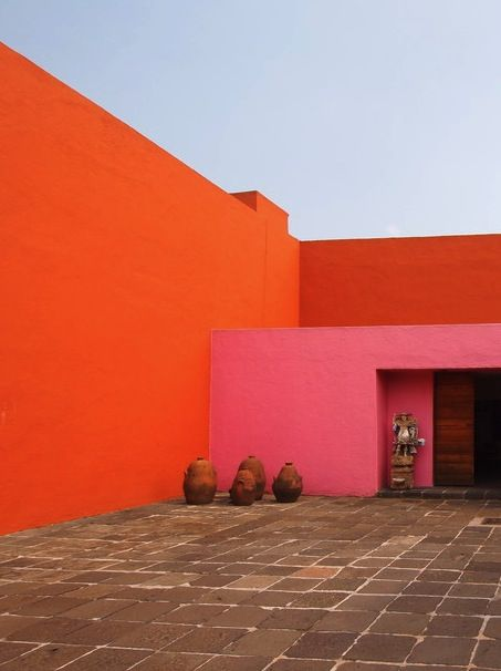 Bright colors and sharp geometric angles. Love this colorful, cultural home.