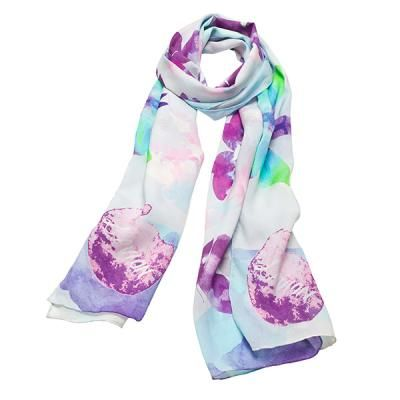 """L'avion Papillion Scarf. Illustrated by Kelly Smith for L'avion - Jardin Collection. """"Our Papillion scarf features a vibrant kaleidoscope of butterflies to form an all over print of blues, greens and purples."""""""