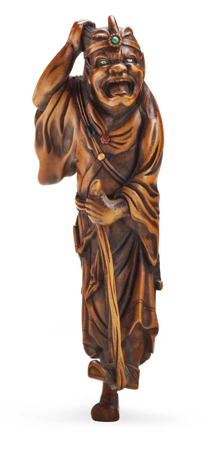 SIGNED KOKEISAI SANSHO (1871-1936), MEIJI - TAISHO PERIOD (EARLY 20TH CENTURY) A carved wood netsuke of a foreign warrior