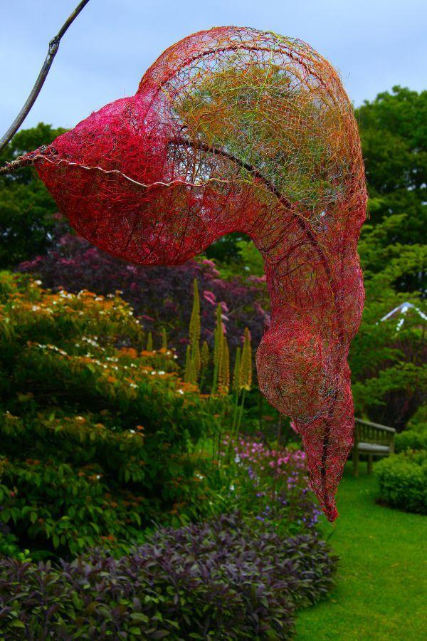 Steel, wire and found materials #sculpture by #sculptor Fiona Campbell titled: 'Cloudless Sulphur (Cocoon garden Transparent statue garden/Yard Art)'. #FionaCampbell  3D flower transparent representation.