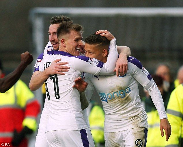 The former Crystal Palace striker is mobbed by team-mates Ritchie and Paul Dummett