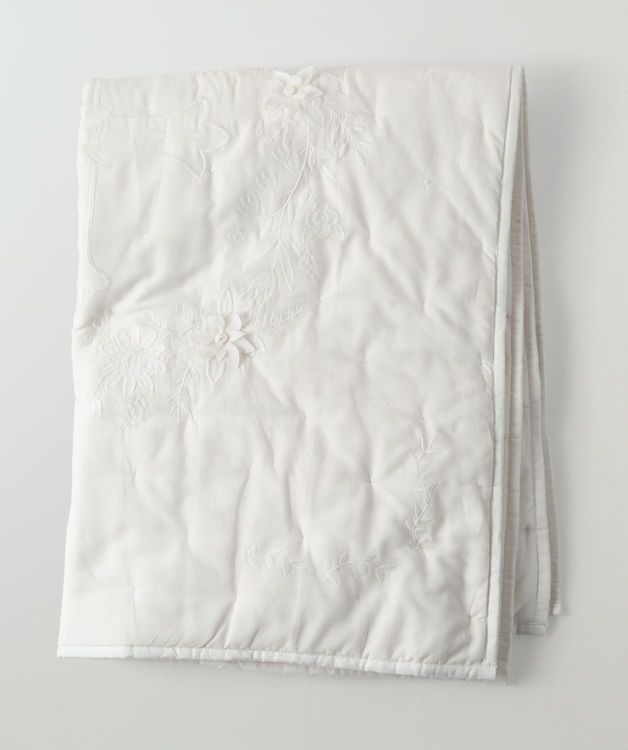 This all ivory, embroidered baby blanket is a wonderful addition to any nursery and also makes the perfect accompaniment to a ceremonial baby outfit for baptisms, christenings or dedications. It's a one-sided design with a large holy cross in the middle, surrounded by two vines of embroidered flowers and leaves, with extra details at both bottom and top. We also offer the option of personalizing this baby blanket with up to three lines of text, so you can place your little's name and a…