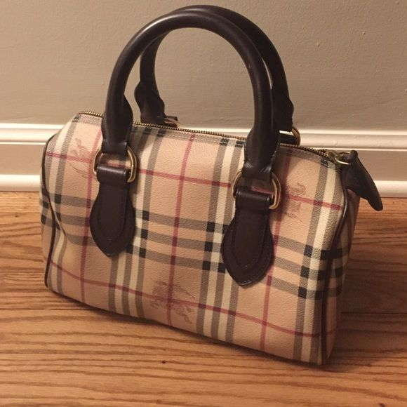 24 hour SALE Burberry Purse On Sale for 24 hours! Only carried it a couple of times and it has just been sitting in my closet. No dust bag. In perfect condition! Great bag just never carry it. Offers welcome! Burberry Bags