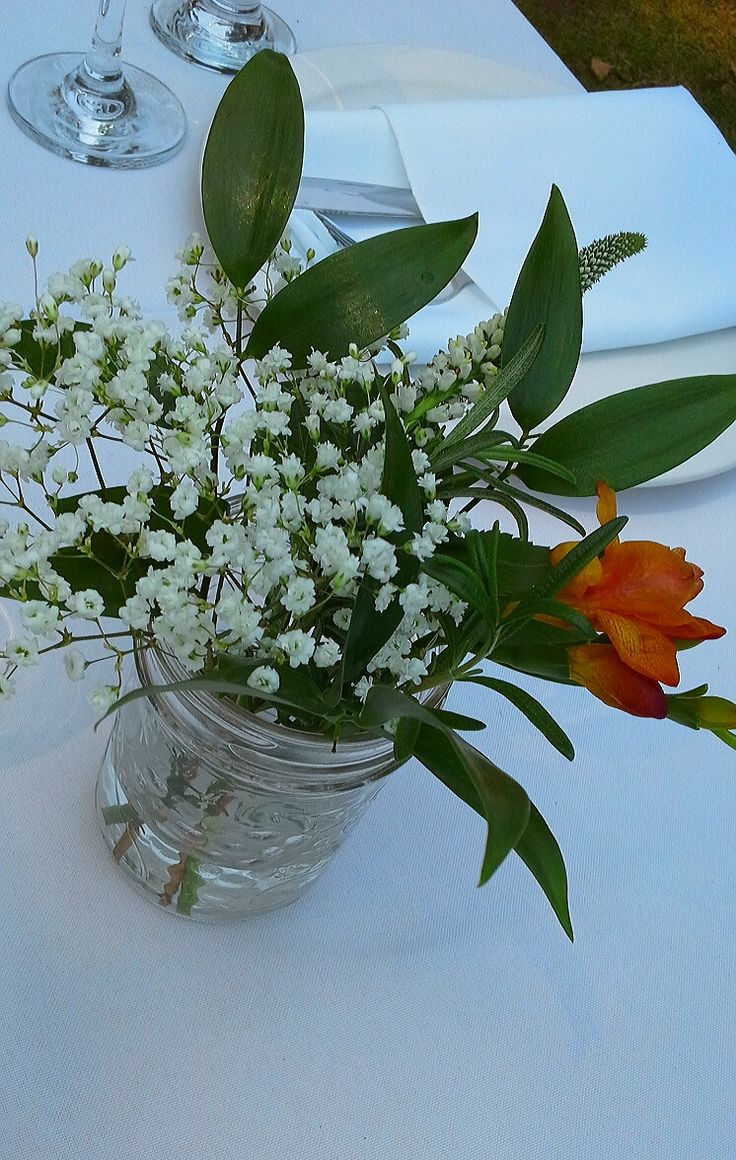 mason jar centerpiece of babies breath, freesia, veronica and rosemary; design by Davis Floral Creations