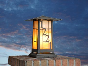 Customized column mounted lantern with customer's house numbers.   Strong Asian influence in this design is classic to Greene & Greene Bungalow architecture.