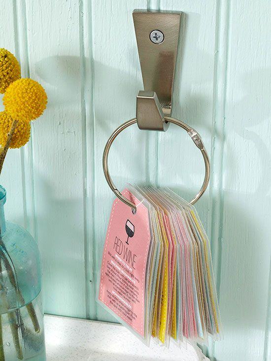 Take the guesswork out of stain removal by keeping a cheat sheet or care guide nearby. Laminated tags with helpful stain-erasing how-tos dangle from a large binder ring above the utility sink.   Download the stain tags here.c
