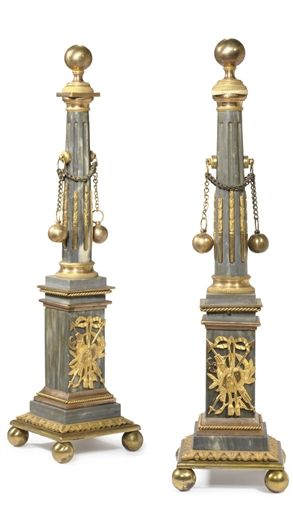 A PAIR OF RUSSIAN ORMOLU AND BLEU TURQUIN OBELISKS LATE 18TH CENTURY Each fluted columnar shaft part-filled with chandelles and suspending balls on chains and surmounted by a sphere, on a rectangular pedestal base mounted with a ribbon-tied martial trophy, on a stepped square base with leaf-tip-cast edge, on ball feet 18 in. (46 cm.) high (2)
