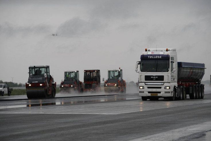 Our hard working people do not mind a little rain. 21,000 square meters of asphalt has been replaced this year on the 04L/22R runway.