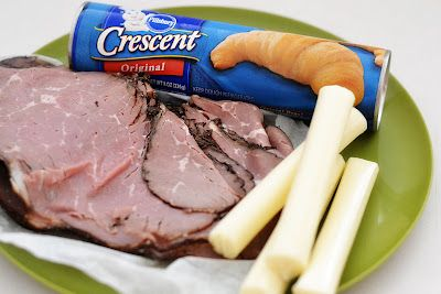 French DIp crescents - 1/2 lb deli roast beef, thinly sliced 4 pcs mozzarella string cheese cut in half, 1 (8 oz) can refrigerated crescent rolls, 1 packet Au Jus or Brown Gravy mix  DIRECTIONS:  Preheat oven to 375 degrees.  Seperate crescent rolls into 8 triangles, roll up with: 1 slice roast beef, 1/2 pc string cheese. Roll up and place on baking sheet. Bake for 14-16 min, or until golden brown.   Make au jus orbrown gravy to accompany them.